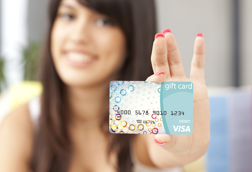 Woman Holing a Visa Gift Card